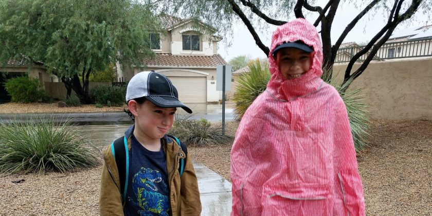 Disney Quick Tip: Pair a Baseball Hat with Your Poncho